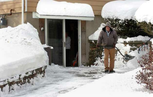 Aftermath and cleanup around Derby, Conn. from a big snowstorm that hit all of New England overnight on Wednesday January 12, 2011. John Buckley shovels snow on his driveway at his home along Ridge Road in Derby. His friend Phil Soderberg did most of the work with his snowblower though. Photo: Christian Abraham / Connecticut Post