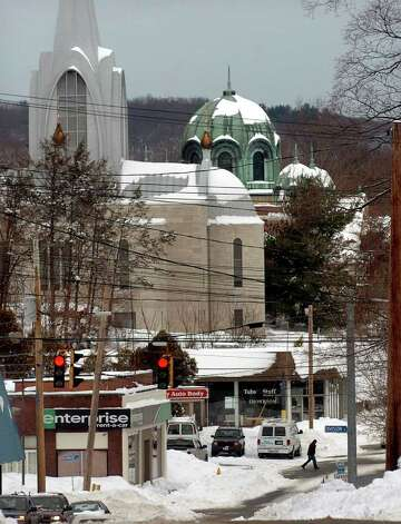 Aftermath and cleanup around Derby, Conn. from a big snowstorm that hit all of New England overnight on Wednesday January 12, 2011. A view of Ansonia from Atwater Street in Derby. Photo: Christian Abraham / Connecticut Post