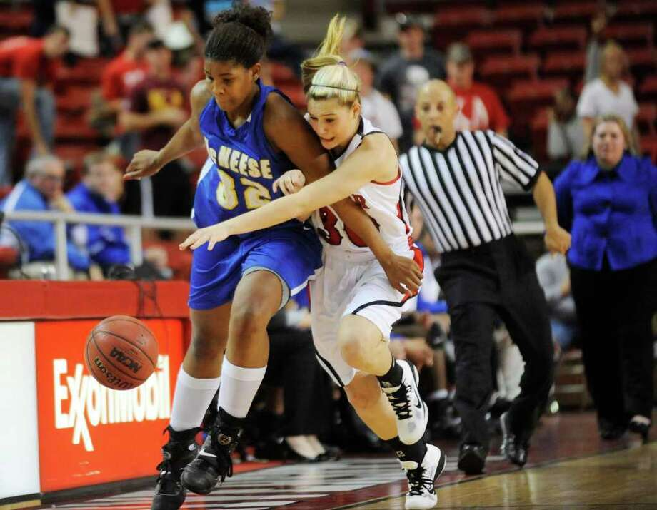 Lady Cardinals guard Taylor Hays, right, battles for a loose ball against  McNeese State's Ja'Niqua Kendrix during their game at the Montagne Center on Wednesday, January 12, 2011. Valentino Mauricio/The Enterprise Photo: Valentino Mauricio / Beaumont