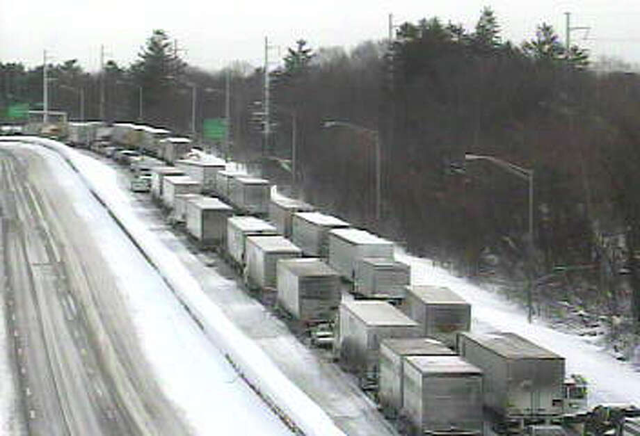 Trucks are backed up in Westport on I-95, which was closed Wednesday morning between exits 18 and 21 because of multiple disabled vehicles. Photo: Contributed Photo/DOT