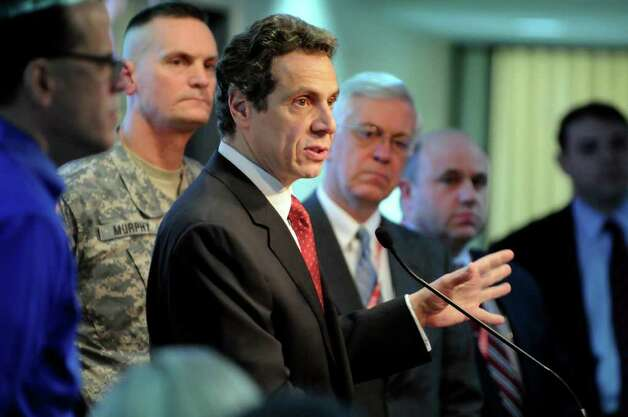 Gov. Andrew Cuomo, center, is getting ready for political storms over the state budget as he speaks to storm trackers Wednesday, Jan. 12, 2011, at the State Emergency Operations Center in Albany, N.Y. (Cindy Schultz / Times Union) Photo: Cindy Schultz