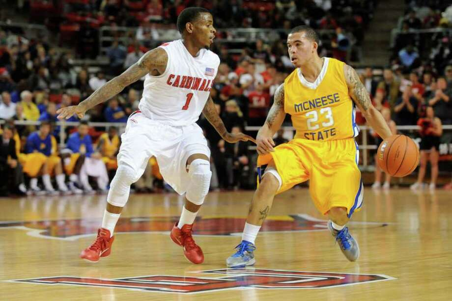 Lamar's Anthony Miles, left, defends against  McNeese State guard C.J. Collins at the Montagne Center on Wednesday, January 12, 2011. Valentino Mauricio/The Enterprise Photo: Valentino Mauricio / Beaumont