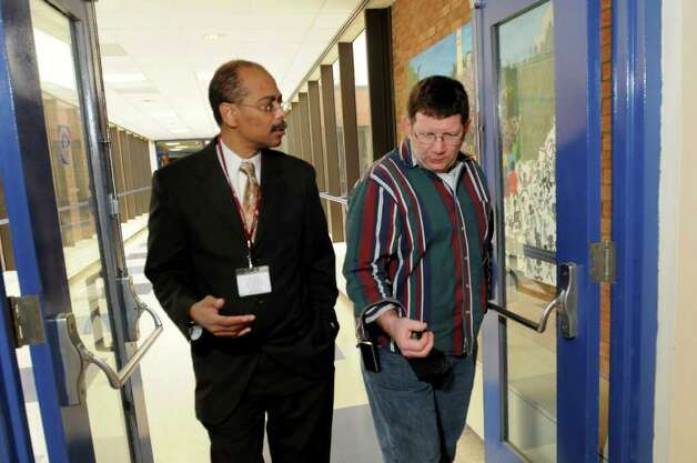 Principal David McCalla, left, walks with social studies teacher Tom McGurn in the hallways of Albany High School. (Cindy Schultz / Times Union) Photo: Cindy Schultz