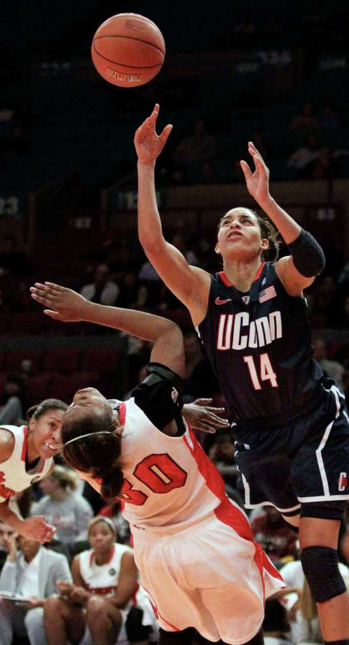 Connecticut's Bria Hartley (14) shoots as St. John's Centhya Hart (30) defends during the first half of an NCAA college basketball game, Wednesday, Jan. 12, 2011, in New York. (AP Photo/Frank Franklin II)