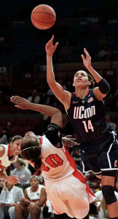 Connecticut's Bria Hartley (14) shoots as St. John's Centhya Hart (30) defends during the first half of an NCAA college basketball game, Wednesday, Jan. 12, 2011, in New York. (AP Photo/Frank Franklin II) Photo: AP