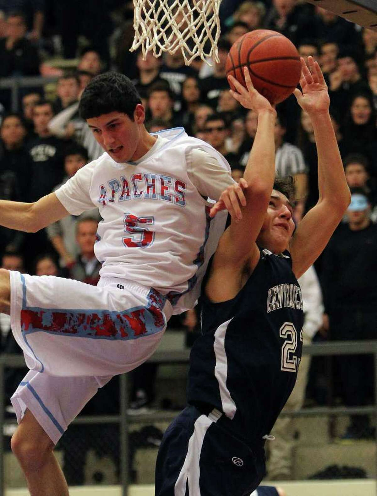 Central Catholic's Philip Betancourt (right) gets fouled as he goes up for shot by Antonian's Eric Garza in boys basketball at Taylor Fieldhouse on Wednesday, Jan. 12, 2011. Central Catholic defeated Antonian 64-54. Kin Man Hui/kmhui@express-news.net