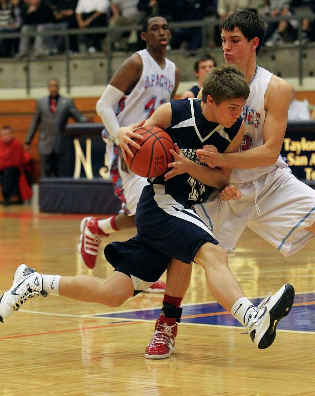 Central Catholic's Collin Fabac (11) drives to basket against Antonian's Mike Boyd (23) in boys basketball at Taylor Fieldhouse on Wednesday, Jan. 12, 2011. Central Catholic defeated Antonian 64-54. Kin Man Hui/kmhui@express-news.net