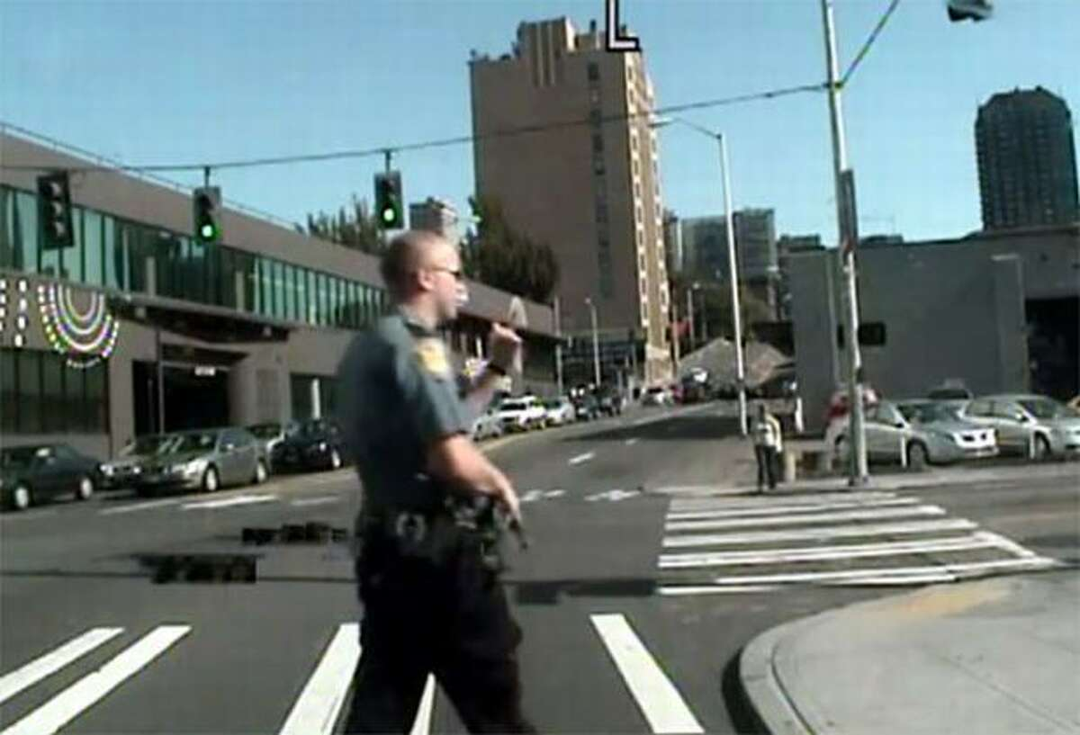 Officer Ian Birk shown by his patrol car camera shortly before fatally shooting John T. Williams. (Seattle Police Department image)