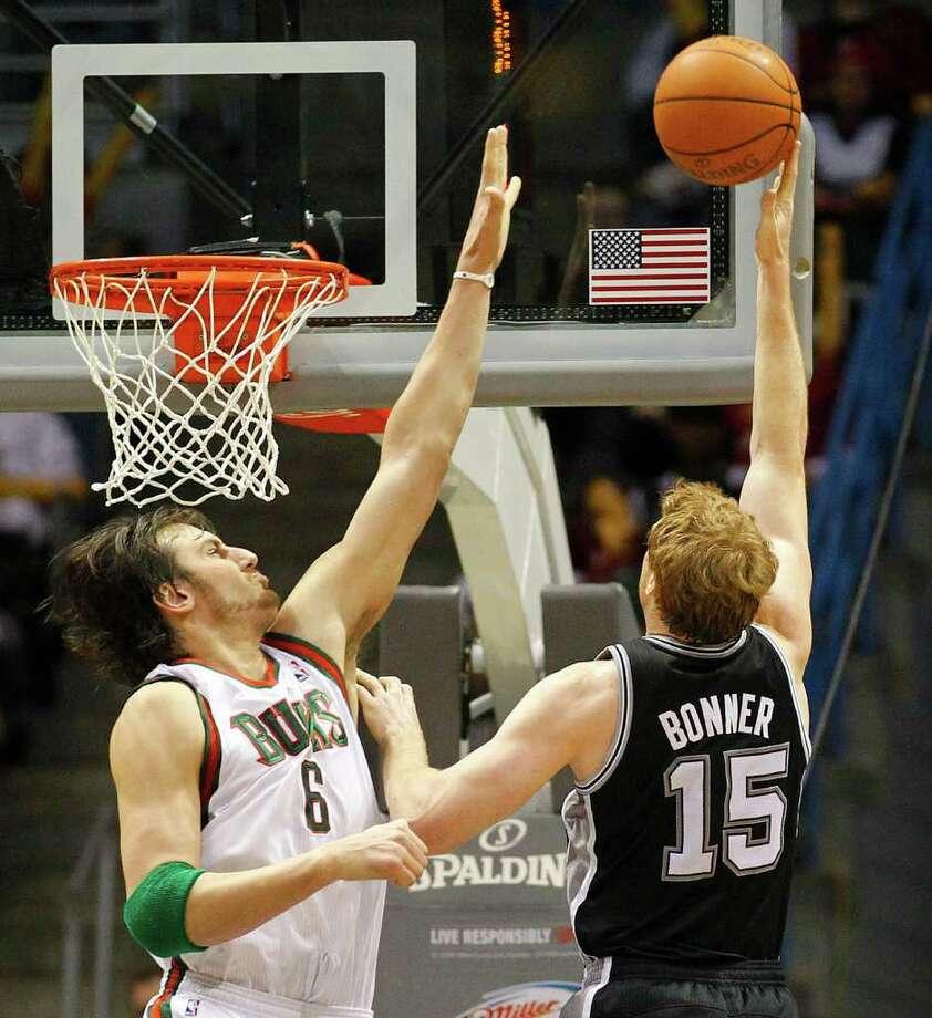 San Antonio Spurs' Matt Bonner(15) puts up a shot against Milwaukee Bucks' Andrew Bogut(6)  in the second half of an NBA basketball game Wednesday, Jan, 12, 2011, in Milwaukee. Photo: AP