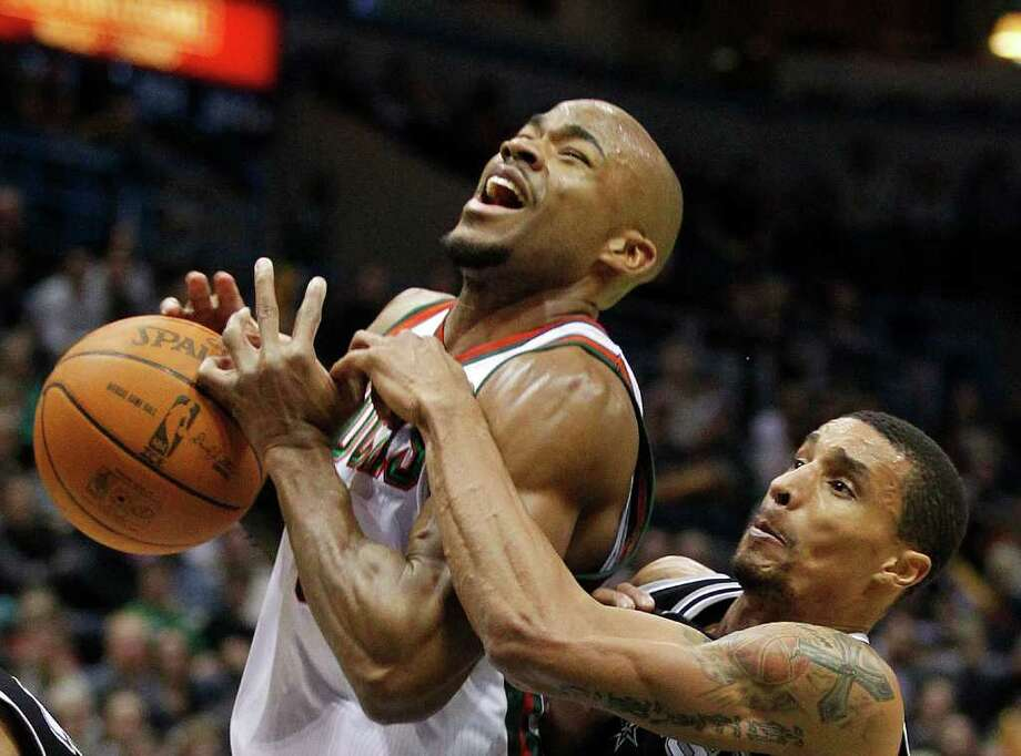 Milwaukee Bucks' Corey Maggette, left, is fouled by San Antonio Spurs' George Hill, right, in the second half of an NBA basketball game Wednesday, Jan, 12, 2011, in Milwaukee. Photo: AP