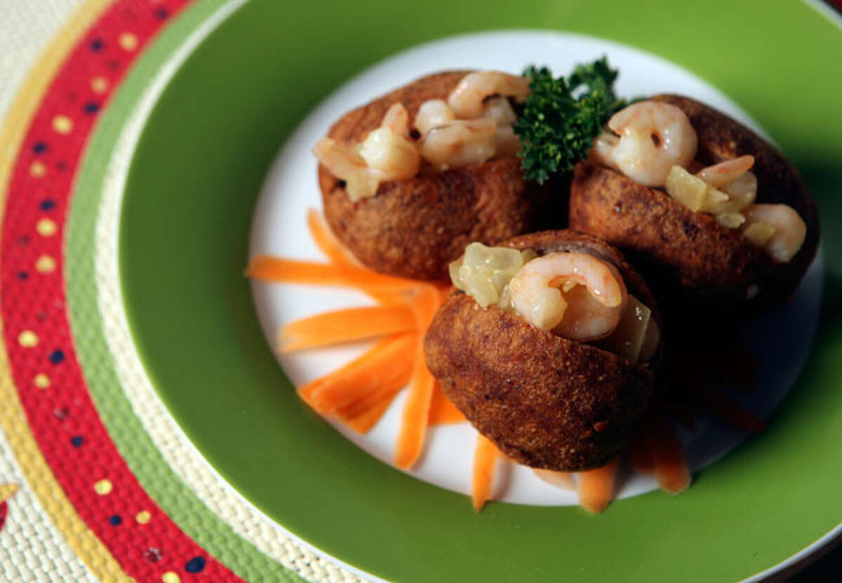 Acarajé, a favorite in the northeastern Brazilian state of Bahia, are black-eyed pea fritters typically stuffed with an onion and shrimp mix.