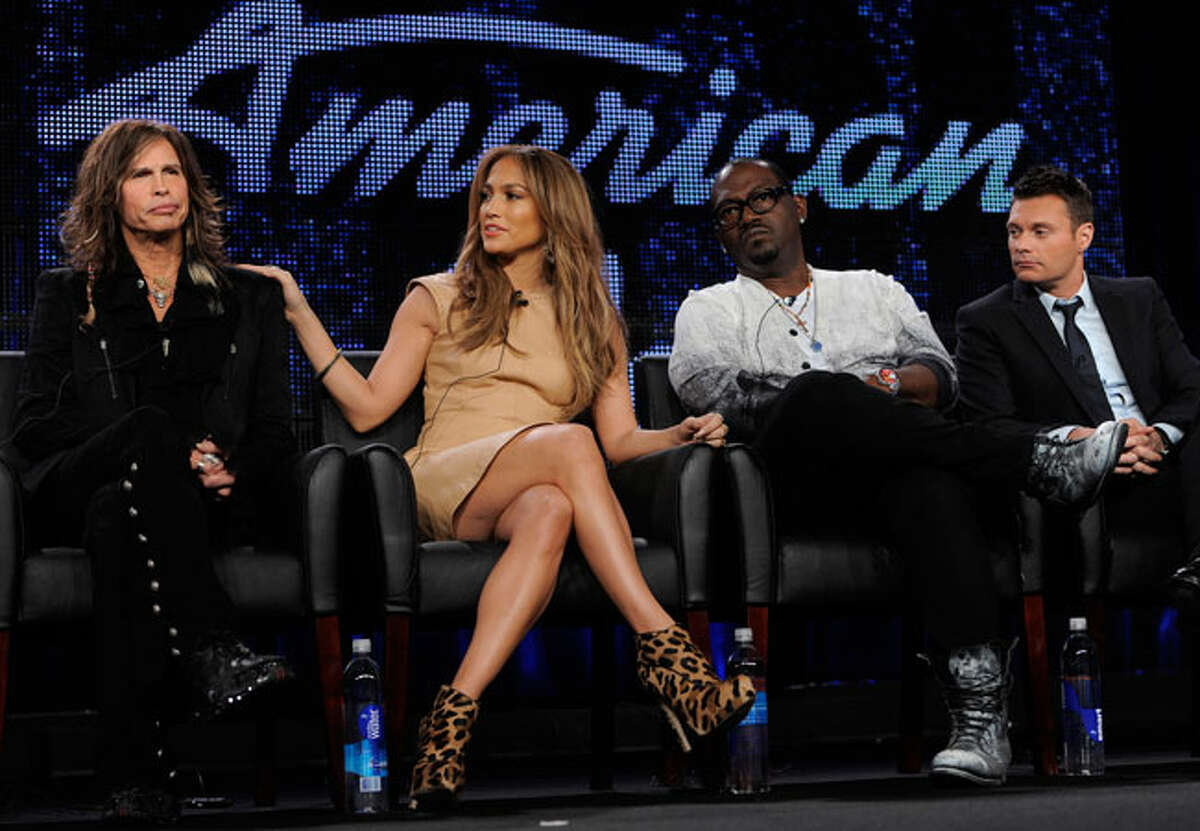 """""""American Idol"""" judges, from left, Steven Tyler, Jennifer Lopez and Randy Jackson, and host Ryan Seacrest take part in a panel discussion on the show during the FOX Broadcasting Company Television Critics Association winter press tour in Pasadena, Calif., Tuesday, Jan. 11, 2011."""