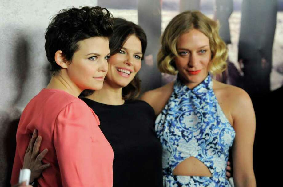 "Ginnifer Goodwin, left, Jeanne Tripplehorn, center, and Chloe Sevigny, cast members in the HBO series ""Big Love,"" pose together at the Season 5 premiere in Los Angeles, Wednesday, Jan. 12, 2011. Photo: AP"