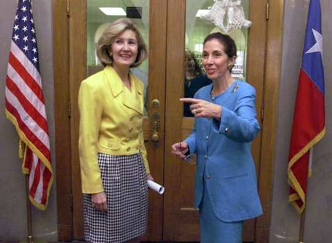 METRO DAILY - Sen. Kay Bailey Hutchison (R-Tex.) talks with Bexar County Judge Cyndi Krier after Hutchison held a press conference discussing the final version of the tax-cut bill approved last week by Congress at the Bexar County Courthouse on Thursday, August 12, 1999. Kin Man Hui/staff. Photo: Kin Man Hui