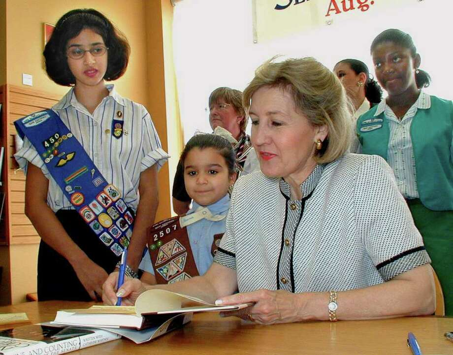 OTS/BROTHERS - 3568 - Stephanie Sanchez (Sr. Girl Scout troop #450), Erica Sweatt (Brownie, troop #2507) and Kay Bailey Hutchison were at the Borders Book store on 8/14 for the book signing by Hutchison. names checked photo by leland a. outz Photo: LELAND A. OUTZ