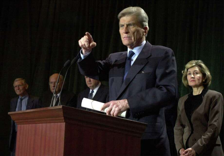 FOR METRO DAILY - Chairman of the Senate Armed Services Committe Sen. John Warner answers questions from the media Monday Jan. 8, 2000 in Austin, Tx.  Sen. Kay Bailey Hutchison is at right. PHOTO BY EDWARD A. ORNELAS/STAFF Photo: EDWARD A. ORNELAS, EN / EN