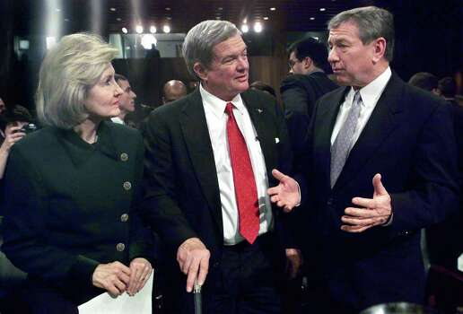 Texas Senator Kay Bailey Hutchison listens to reactions from Senator John Ashcroft after the Senate Judicial Committee broke midway through confirmation hearings for the Bush appointee to Attorney General.  Listening in is Kit Bond, U.S. Senator from Missouri.   Photo by Tom Reel   January 16 Photo: TOM REEL , EN / EN