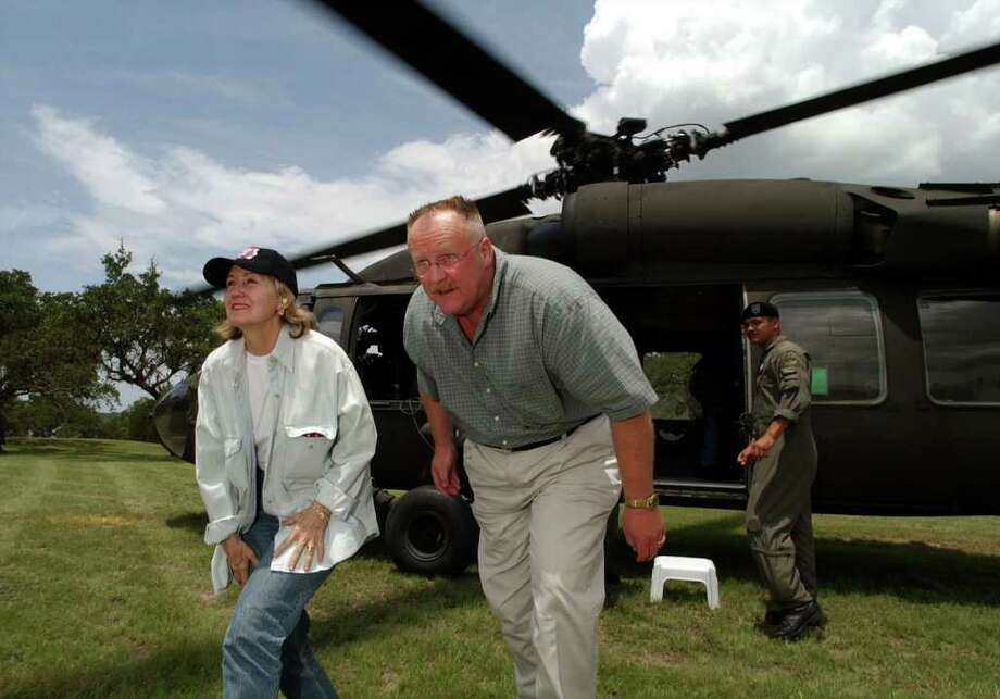 FOR METRO DAILY - U.S. Senator Kay Bailey Hutchison(left) and FEMA Director Joe Allbaugh exit a Blackhawk helicopter after a flyover of the damage area caused by the 2002 flood Friday July 12, 2002 at Canyon Lake. PHOTO BY EDWARD A. ORNELAS/STAFF Photo: EDWARD A. ORNELAS, SAN ANTONIO EXPRESS-NEWS / SAN ANTONIO EXPRESS-NEWS