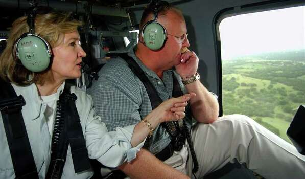 FOR METRO DAILY - U.S. Senator Kay Bailey Hutchison(left) and FEMA Director Joe Allbaugh flyover a section of the flooddamaged area near Canyon Lake in a Blackhawk helicopter Friday July 12, 2002. PHOTO BY EDWARD A. ORNELAS/STAFF Photo: EDWARD A. ORNELAS, SAN ANTONIO EXPRESS-NEWS / SAN ANTONIO EXPRESS-NEWS