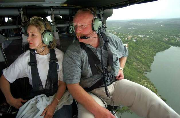 FOR METRO DAILY - U.S. Senator Kay Bailey Hutchison(left) and FEMA Director Joe Allbaugh tour a section of the flooddamaged area near Canyon Lake in a Blackhawk helicopter Friday July 12, 2002. PHOTO BY EDWARD A. ORNELAS/STAFF Photo: EDWARD A. ORNELAS, SAN ANTONIO EXPRESS-NEWS / SAN ANTONIO EXPRESS-NEWS