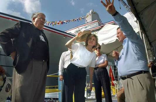 METRO   SENATOR KAY BAILEY HUTCHISON leans to look down the length of the a new ship to be christened the USS San Antonio.  Escorting her during a tour of the new vessel at the Avondale shipyard near New Orleans are Northrop Grumman officials George R. Yount (left) and Jim McIngvale.  Tom Reel/Staff   July 18, 2003. Photo: TOM REEL, SAN ANTONIO EXPRESS-NEWS / SAN ANTONIO EXPRESS-NEWS