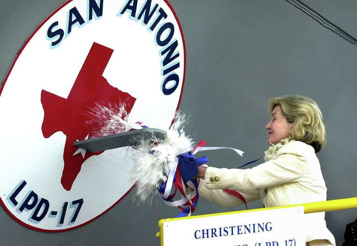 Sen. Kay Bailey Hutchison breaks a bottle of Texas bubbly to christen the LPD-17 ship to be commissioned as the USS San Antonio. The ceremony took place Saturday, July 19, 2003, at the Northrop Grumman Ship System Avondale plant near New Orleans.