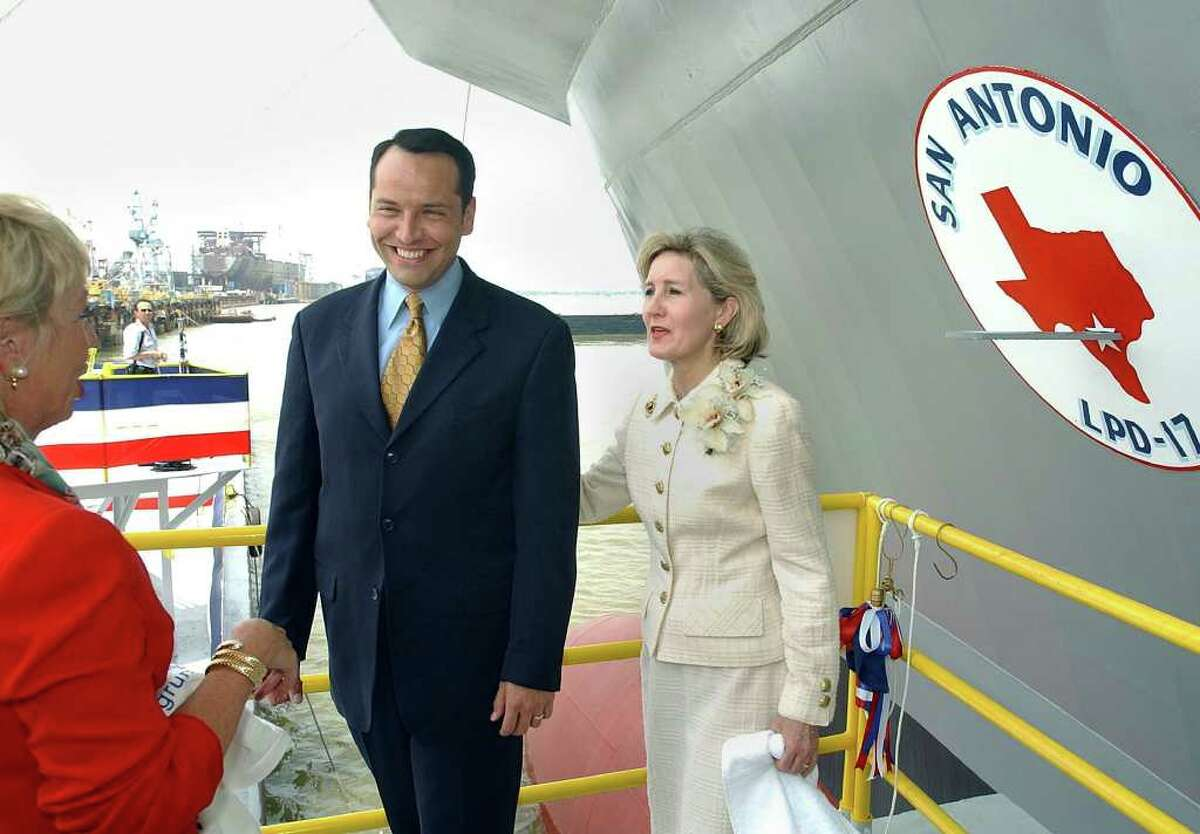 METRO SAN ANTONIO MAYOR ED GARZA, is greeted by Trisha Wilson, one fo the Matrons of Honor at the christening of the LPD-17 ship to be commissioned as the USS San Antonio. He was standing on the christening platform with Texas Senator Kay Bailey Hutchison . The ceremony took place Saturday, July 19, 2003 at the Northrop Grumman Ship System Avondale plant near New Orleans.