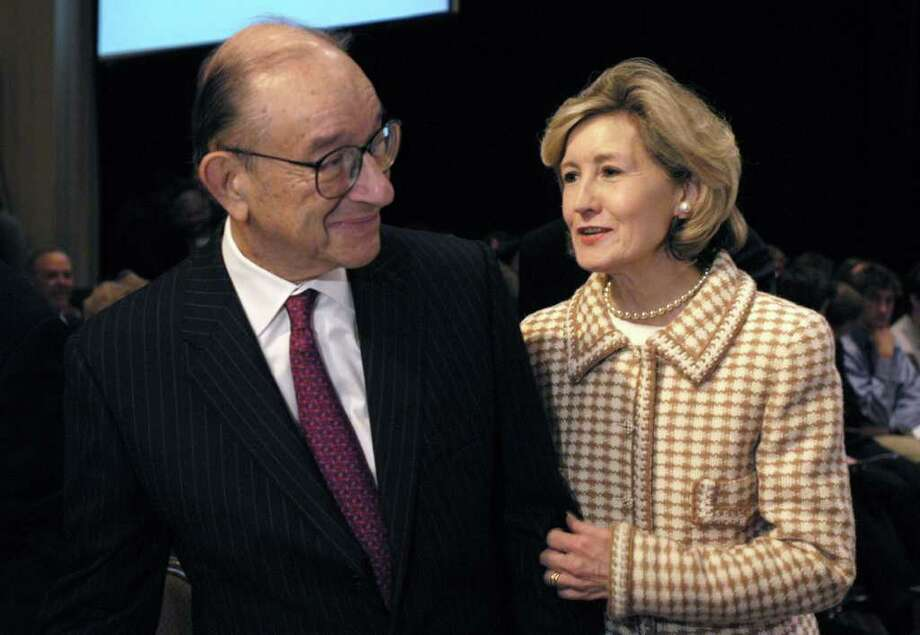 Alan Greenspan, chairman of the Federal Reserve Board of Governors, speaks with Senator Kay Bailey Hutchison (R-TX) at a World Affairs Council luncheon in Dallas, Texas, Thursday, December 11, 2003.  He said China may need to end its currency peg to the U.S. dollar in order to keep its economy from overheating, not because such a shift would lead to more U.S. jobs and exports.  Photographer:  Jon Freilich/ Bloomberg News. Photo: Jon Freilich, Bloomberg News
