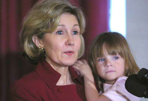 Sen. Kay Bailey Hutchison, R-Texas, holds her two-year-old daughter Bailey during a Capitol Hill news conference Thursday, April 22, 2004 promoting Take Our Daughters and Sons To Work Day. Sponsored by the Ms. Foundation, it's designed to encourage students to think now about the careers they want and the choices needed to reach those dreams. Photo: HANS ERICSSON, AP / AP