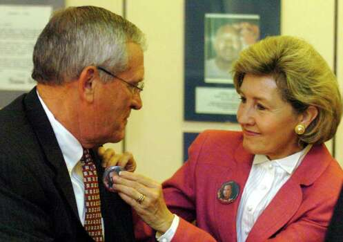 "METRO -- U.S. Senator Kay Bailey Hutchison, right, pins a button bearing a picture of Polly Klaas who was abducted at the age of 12 in 1983 onto the jacket of SBC Chairman and CEO  Ed Whitacre at the Heidi Search Center in Windsor Park Mall Monday August 2, 2004.  The buttons were passed out by Polly's father Marc Klaas, the president of the non-profit BeyondMissing, Inc.  Whitacre, Hutchison and Klaas were at a press conference to announce $1 million in technology funding by the SBC Foundation to enhance AMBER Alert projects in the 13 states served by SBC.  The buttons read: ""Polly we love you."" Photo: ROBERT MCLEROY, SAN ANTONIO EXPRESS-NEWS / SAN ANTONIO EXPRESS-NEWS"