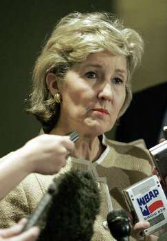 U.S. Sen. Kay Bailey Hutchison, R-Texas, listens to questions from the media in Plano, Texas, Friday, June 17, 2005.  Hutchison won't be running for governor of Texas. Her campaign manager late today announced Hutchison will be seeking re-election to the Senate. Photo: LM OTERO, AP / AP
