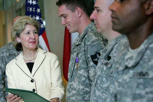 U.S. Sen. Kay Bailey Hutchison, left, give U.S. Army Private First Class Sonny Weldon his Purple Heart Display Certificate during a ceremony at the Center for the Intrepid on Tuesday, Aug. 7, 2007. With Weldon were Staff Sgt. James Swinney, second from right, and First Sgt. Michael Haynes, right. ( JERRY LARA STAFF ) Photo: JERRY LARA, SAN ANTONIO EXPRESS-NEWS / SAN ANTONIO EXPRESS-NEWS