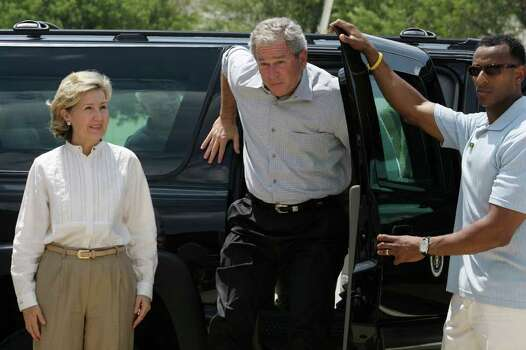 METRO -- U.S. President George W. Bush, center, and U.S. Senator Kay Bailey Hutchison arrives to greet  Hurricane Gustav volunteers at Port San Antoinio on Monday, Sept. 1, 2008. JERRY LARA/glara@express-news.net Photo: JERRY LARA, SAN ANTONIO EXPRESS-NEWS / glara@express-news.net