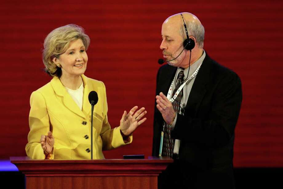 ST. PAUL, MN - SEPTEMBER 03:  U.S. Sen. Kay Bailey Hutchison (R-TX) stands at the podium with stage manager Howard Kolins during a walk thru on day three of the Republican National Convention (RNC) at the Xcel Energy Center on September 3, 2008 in St. Paul, Minnesota. The GOP will nominate U.S. Sen. John McCain (R-AZ) as the Republican choice for U.S. President on the last day of the convention. Photo: Alex Wong, Getty Images / 2008 Getty Images