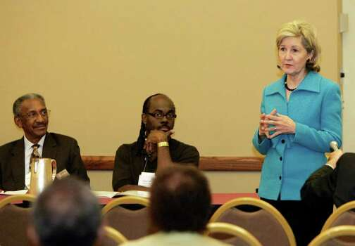 "METRO; HUTCHISON 1011 JMS; 10/10/08; Lloyd Miller, from the left, and Terry Mills look on as U. S. Senator Kay Bailey Hutchison speaks to the 72nd Annual NAACP state convention at the Airport Hilton in San Antonio, Friday, Oct. 10, 2008. When asked to rate on a scale of one to ten, how likely she was to make a run at the Texas gubernatorial seat, Hutchison answered, ""Ten."" Photo: J. MICHAEL SHORT, SPECIAL TO THE EXPRESS-NEWS / THE SAN ANTONIO EXPRESS-NEWS"