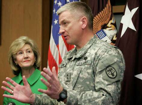 Sen. Kay Bailey Hutchison (R-TX) looks on as Maj. Gen. Russell Czerw speaks to the media about the BRAC related expansion at Ft. Sam Houston in San Antonio, Texas on Monday, February 16, 2009. Photo: Alicia Wagner Calzada, SPECIAL TO THE EXPRESS-NEWS / Alicia Wagner Calzada