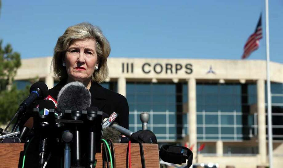 FOR METRO - Senator Kay Bailey Hutchison answers questions from the media outside of III Corps headquarters where an American flag flies at half-staff Friday Nov. 6, 2009 on Fort Hood Army Base in Fort Hood, Tx. PHOTO BY EDWARD A. ORNELAS/eaornelas@express-news.net) Photo: EDWARD A. ORNELAS, SAN ANTONIO EXPRESS-NEWS / eaornelas@express-news.net