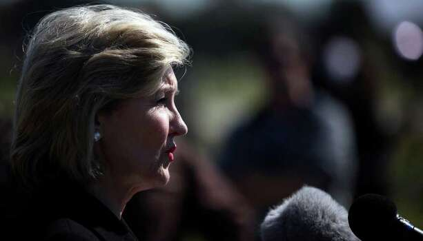 FOR METRO - Senator Kay Bailey Hutchison answers questions from the media outside III Corps headquarters Friday Nov. 6, 2009 on Fort Hood Army Base in Fort Hood, Tx. PHOTO BY EDWARD A. ORNELAS/eaornelas@express-news.net) Photo: EDWARD A. ORNELAS, SAN ANTONIO EXPRESS-NEWS / eaornelas@express-news.net