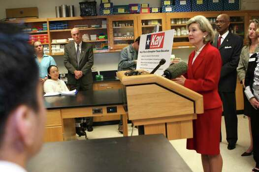U.S. Sen. Kay Bailey Hutchison, right, discusses her education initiatives, she will pursue if elected governor of Texas, to a group of college biotechnology students, Tuesday, Nov. 24, 2009, at Collin County Community College Spring Creek Campus in Plano, Texas. Hutchison is challenging Gov. Rick Perry in the Republican primary for governor next March. Photo: AP