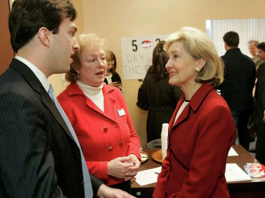 METRO; HUTCHISON JMS; 01/08/10; Senator and gubernatorial candidate Kay Bailey Hutchison, right, talks with Carl Holshouser, left, and her local campaign chairman Carol Van De Walle, center, as she opens her San Antonio campaign headquarters amid press and many supporters, Friday, January 8, 2010, in San Antonio. ( Photo J. Michael Short  ) Photo: J. MICHAEL SHORT, SPECIAL TO THE EXPRESS-NEWS / ©2010 J. MICHAEL SHORT