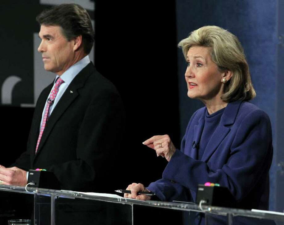 Republican candidates for Texas Governor U.S. Sen. Kay Bailey Hutchison, right, and Texas Gov. Rick Perry, left, are seen during a debate at the WFAA Channel 8 studios in downtown Dallas on Friday, Jan. 29, 2010. Photo: AP