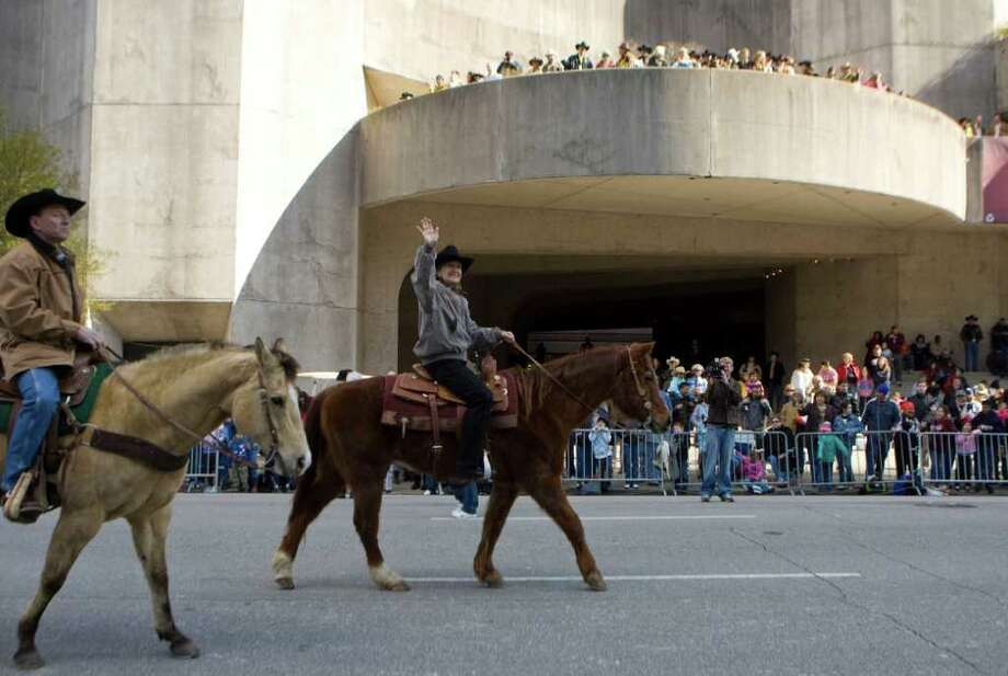 Sen. Kay Bailey Hutchison, Republican candidate for Texas governor, rides in the Houston Livestock Show and Rodeo Parade in downtown Houston on Saturday, Feb. 27, 2010. Rancher Joe Schindler, left, rides with Hutchison in the parade. Photo: AP
