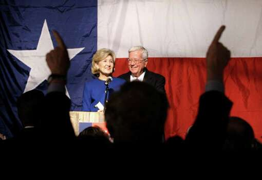 Sen. Kay Bailey Hutchison, R-Texas, left, and her husband Ray, look on as supporters show their support following her speech conceding from the Republican nomination for Texas governor in Dallas on Tuesday, March 2, 2010. Photo: AP