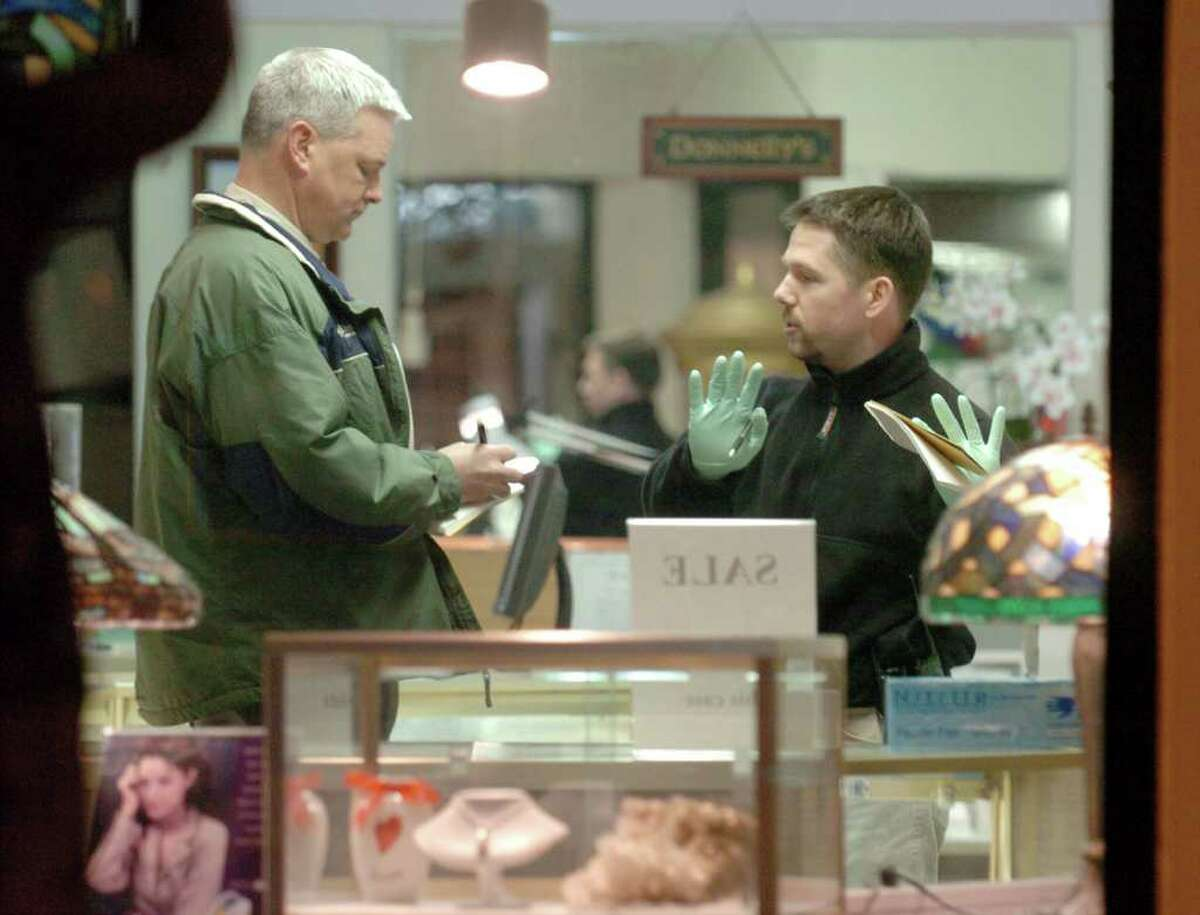 Fairfield Police detectives investigate the scene of a shooting inside Donnelly Jewelry in downtown Fairfield, Conn. Wednesday evening, Feb. 2, 2005. The store owners, Kimberly Ann Donnelly, and her husband Timothy Donnelly, both 52, were shot to death in an apparent robbery.