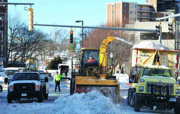 Stamford City of Operations crews remove snow in Columbus Park in Stamford, Conn, on Wednesday January 13, 2011. Photo: Kathleen O'Rourke / Stamford Advocate