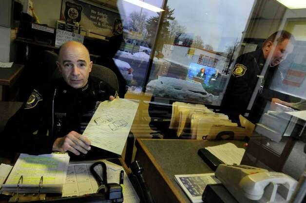Albany Police investigator Bill Wilson holds a towing form at Albany's Traffic Safety Building in Albany Thursday Jan. 13, 2011.( Michael P. Farrell/Times Union ) Photo: Michael P. Farrell