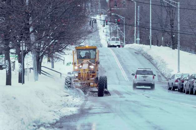 A Troy city employee runs a road grader along 8th St. to clean up the edges of the road on Thursday, Jan. 13, 2011. (Paul Buckowski / Times Union) Photo: Paul Buckowski / 10011748A