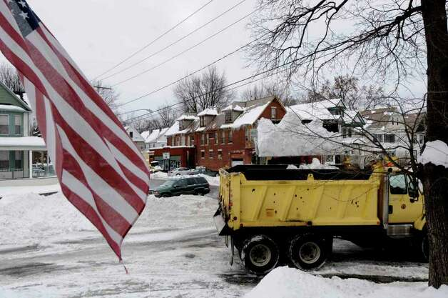 A Schenectady bulldozer and dump truck clear snow from the corner of Parkwood Boulevard and Rugby Road in Schenectady Thursday Jan. 13, 2011.( Michael P. Farrell/Times Union ) Photo: Michael P. Farrell