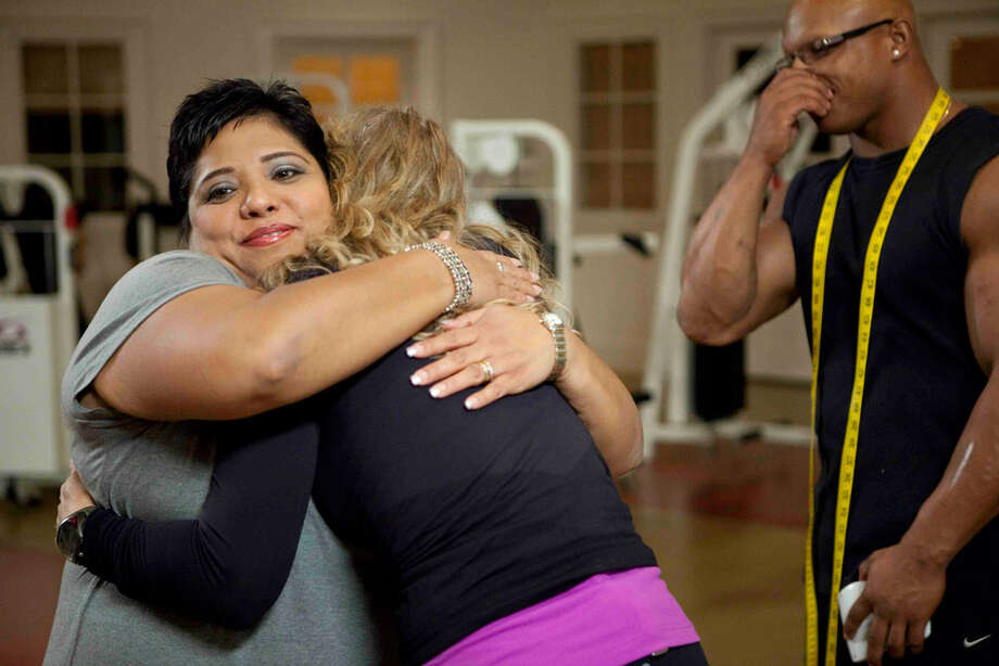 """""""Heavy"""" participant Flor Cox (left) of San Antonio gets a hug from personal trainer Britny Fowler."""