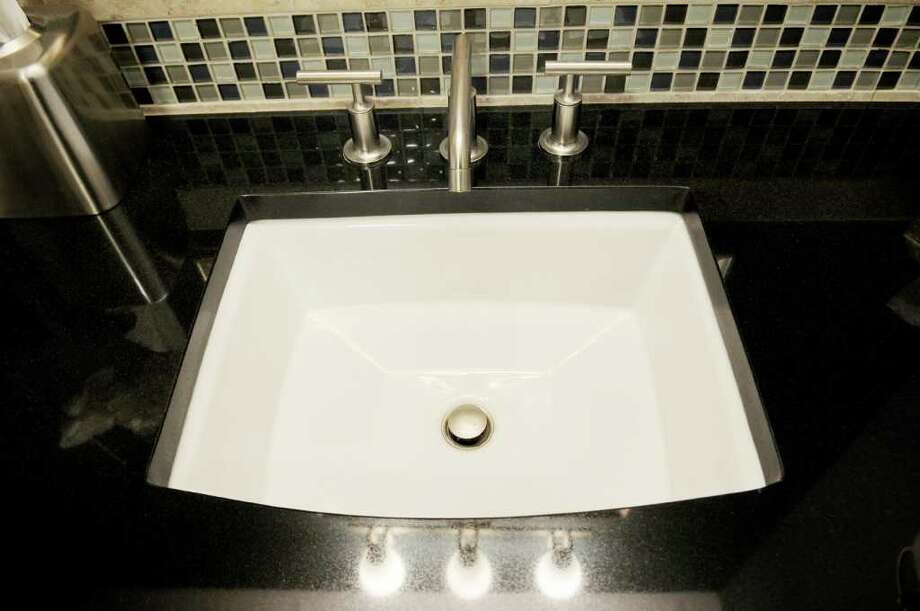 A Kohler bathroom sink made of china is in the design center at 17 Chapel in Albany. (Luanne M. Ferris / Times Union) Photo: Luanne M. Ferris